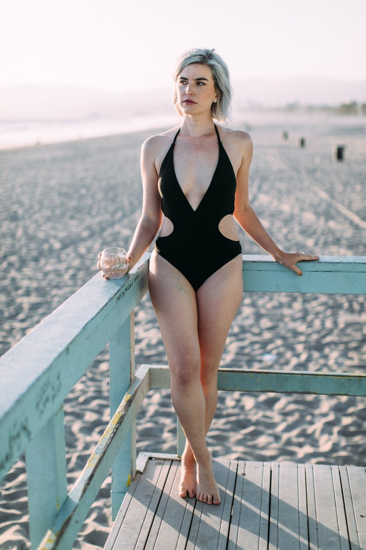 tall woman wearing express one-piece
