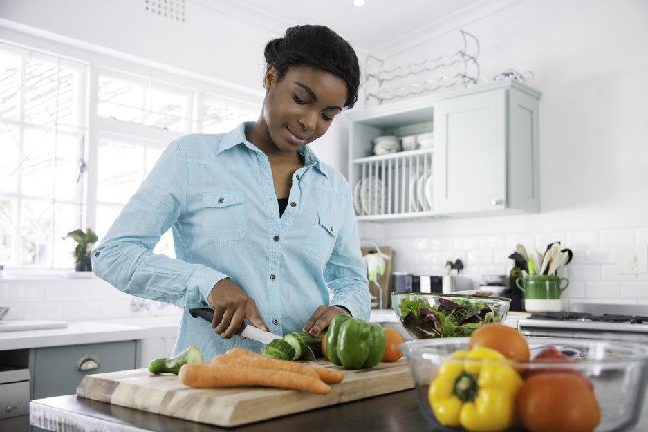 Woman chopping vegetables for healthy recipes