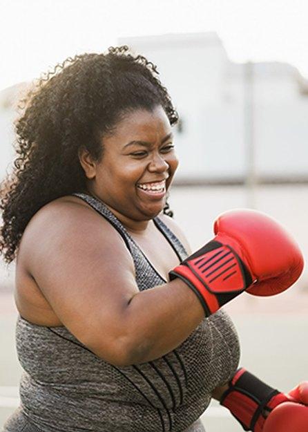 woman doing boxing workout outside