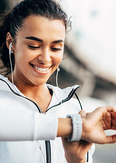 woman checking physical activity on fitness tracker