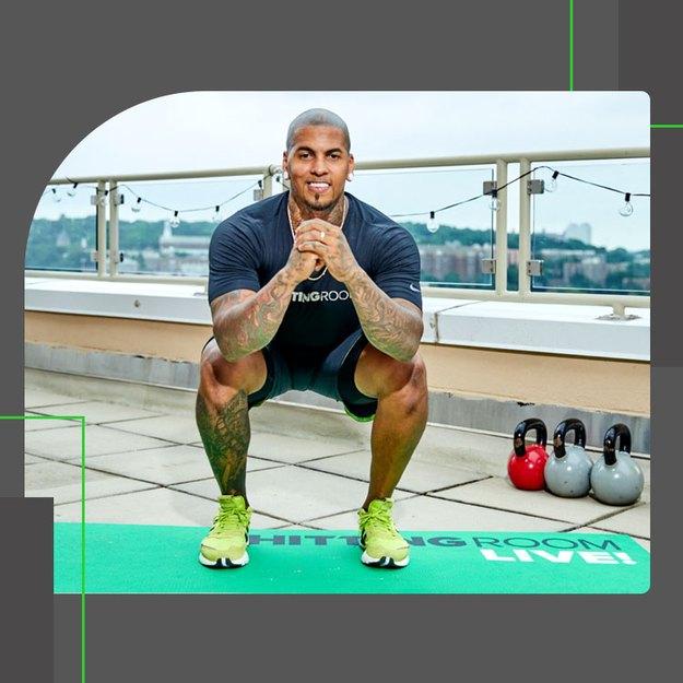 fhitting room trainer demonstrating proper squat form