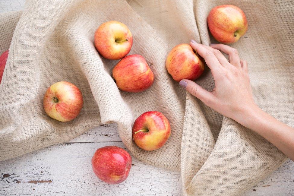 Woman's hand grabbing apples